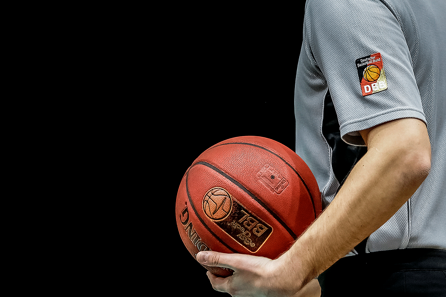 Baskteball Bundesliga referee with official BBL ball