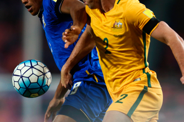 australian football player disputing ball